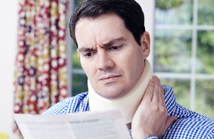Man with whiplash reads medical records